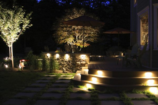 LED Landscaping Lighting Shining On New Deck With Stone Walls In Long Valley, New Jersey By Madlinger Exterior Design LLC