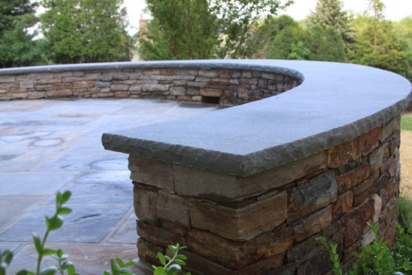 Madlinger Exterior Design curved stone wall with curved bluestone cap in flemington new jersey-min