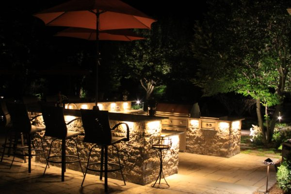 Madlinger Exterior Design large outdoor kitchen with raised bar granite counter tops and led low voltage lighting in basking ridge new jersey-min