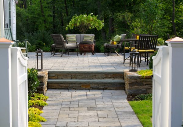 Madlinger Exterior Design paver walkway leading to raised patio flanked by two walpole gates with hydrangea tree centered on walkway in Basking Ridge New Jersey-min