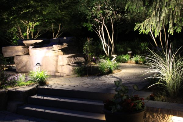 Madlinger Exterior Design pool spa with waterfall light up with led low voltage landscape lighting in basking ridge new jersey-min