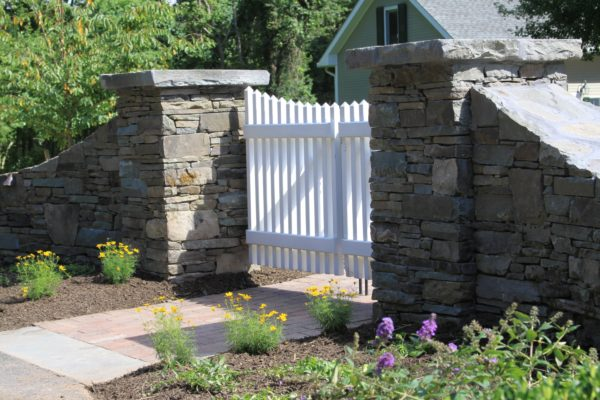 Madlinger Exterior Design stone pillars with white picket fence gate in pittstown new jersey-min