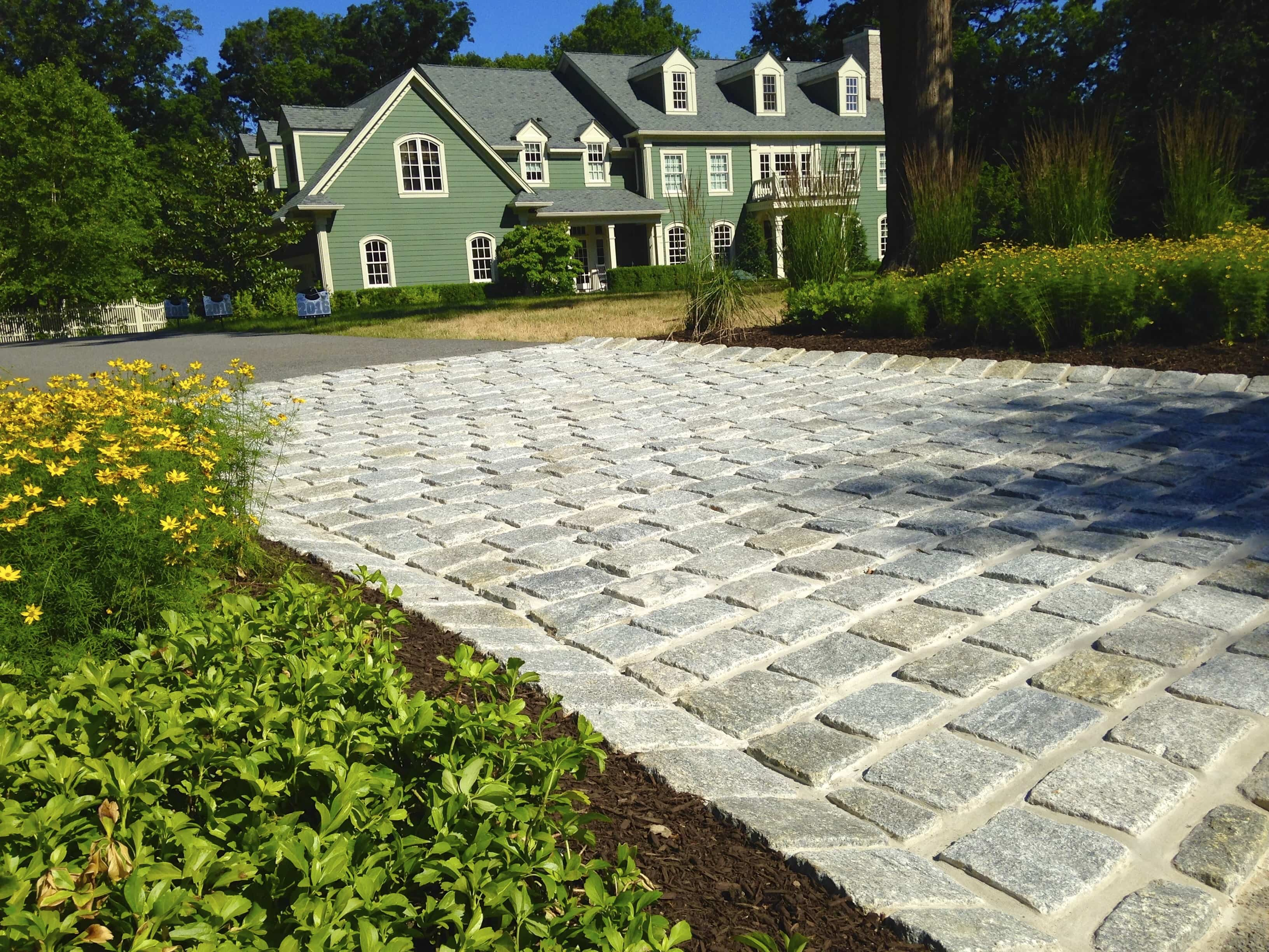 Madlinger Exterior Design LLC Granite cobble driveway apron in Basking Ridge, New Jersey