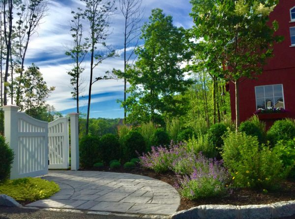 White picket fence gate leading into back yard in Basking Ridge, New Jersey